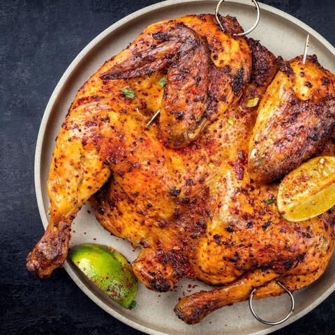 Peruvian Spatchcock Chicken with Creamy Cilantro Sauce