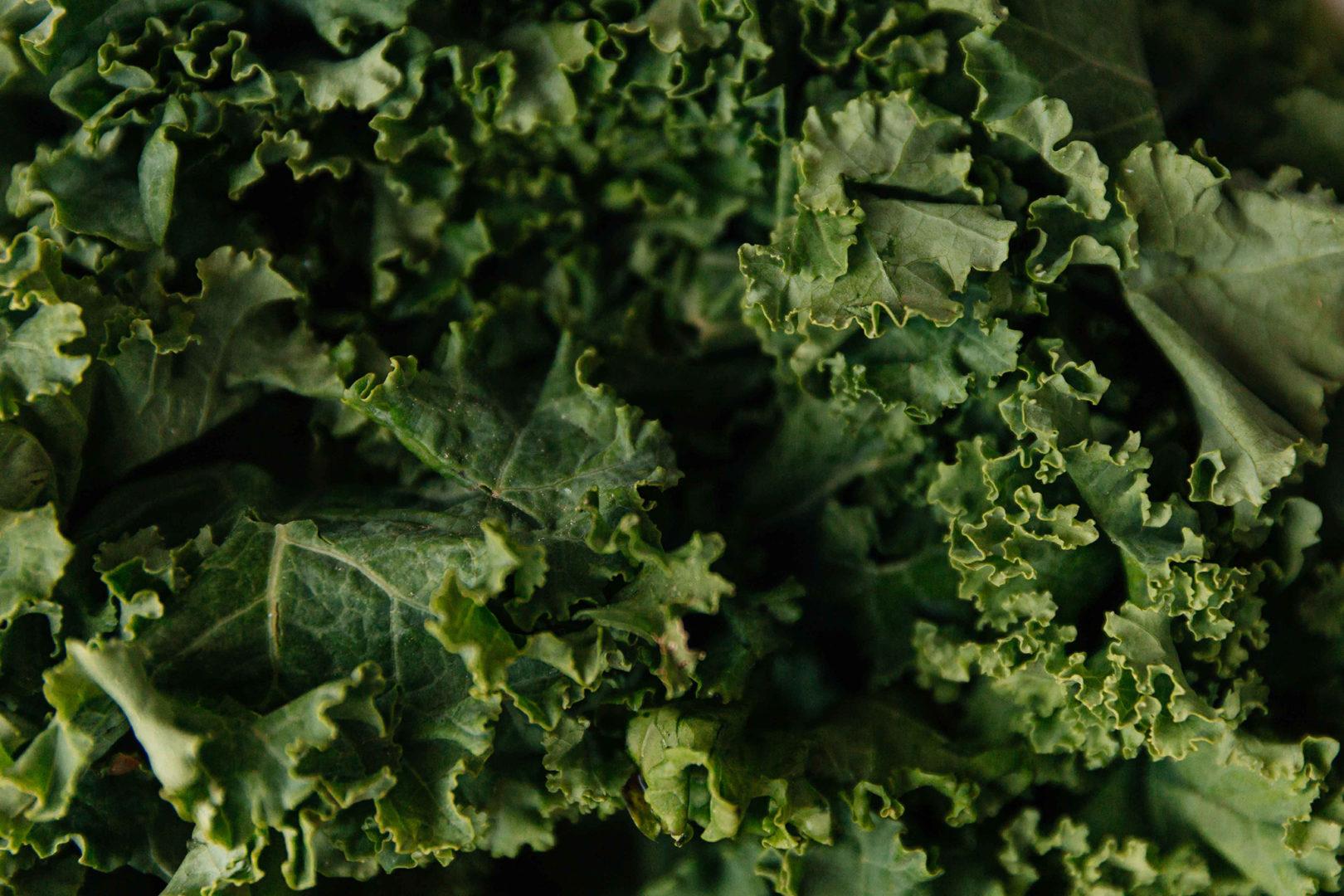 leafy green kale in potato skillet