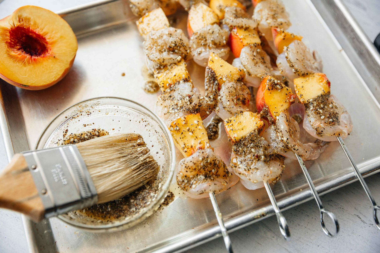 shrimp skewer with chimichurri and peaches